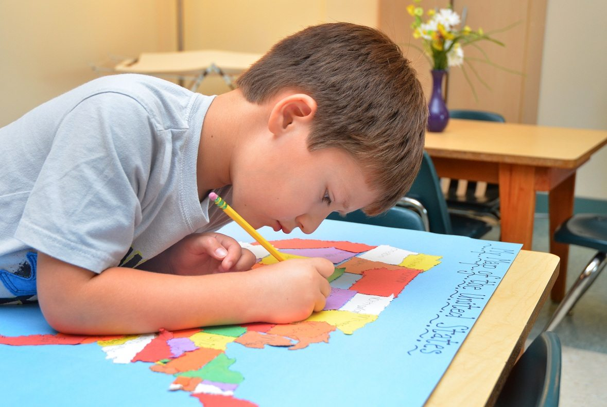 Kindergarten child doing geography work
