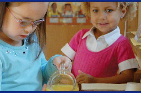 Preschool children working on practical life