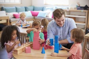 Preschoolers working with Montessori materials
